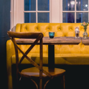 Bench Seating upholstered by Oswall and Rose in Yarwood Leather Mustang Mustard. Photography by Salt Media