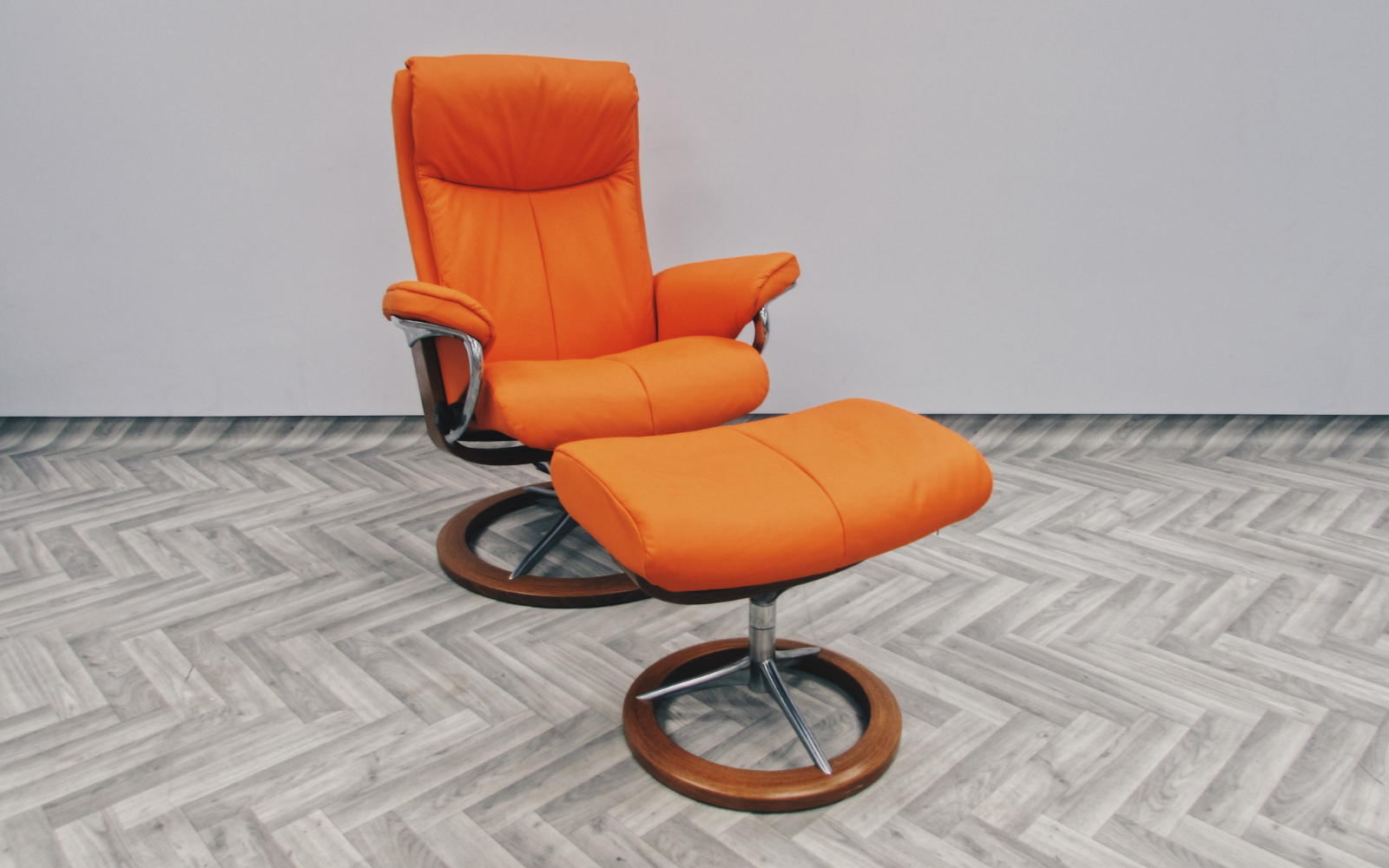 Bright Orange leather chair and accompanying footstool